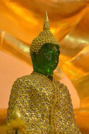 blissfulness: Emerald Buddha with winter concept and golden background