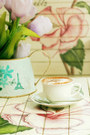 coziness: hot cappuccino on paint wooden table with vintage style  Stock Photo