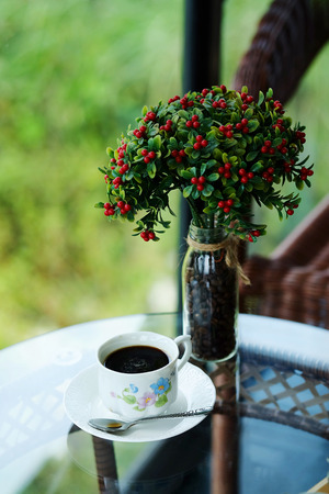 potation: relaxing with hot black americano coffee Serve in white cup in garden in the afternoon