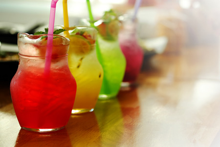 eagerly: colorful cold Italian soda   syrup Serve in jar with garden restaurant background Stock Photo