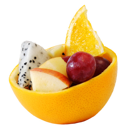 beautify: mix fruit salad Served in creative orange rind bowl with white isolate background