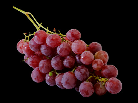 Bunches of fresh red grapes with black isolate background Stock Photo
