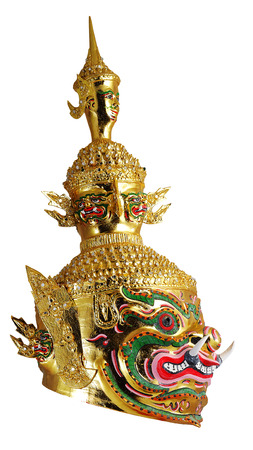 Thai Khon mask head called Tossakan when in Golden face, Ramakian Story. White Isolated background Stock Photo