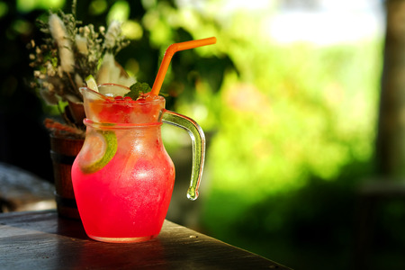 joyousness: Cool Red Punch refreshment in garden cafe background