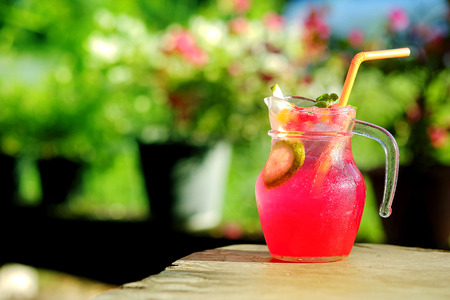 potation: Cool Red Punch refreshment in garden cafe background