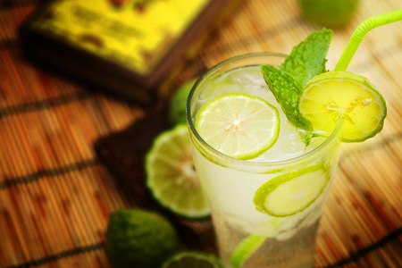 acid reflux: Kaffir lime, Bergamot soda Cool drink, Herb for Treatment of Acid Reflux, with Earth tone background Stock Photo