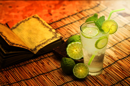 eagerly: Kaffir lime, Bergamot soda Cool drink, Herb for Treatment of Acid Reflux, with Earth tone background Stock Photo