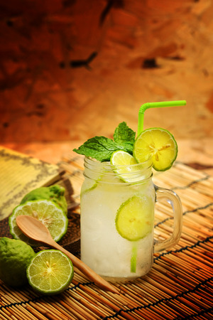 potation: Kaffir lime, Bergamot soda Cool drink, Herb for Treatment of Acid Reflux, with Earth tone background Stock Photo