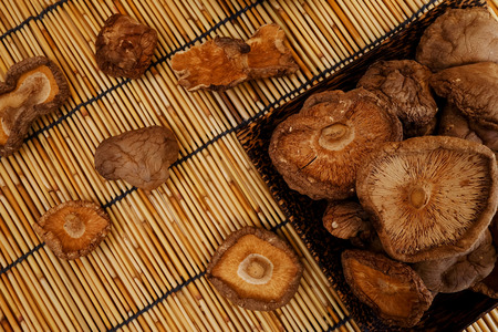 earth tone: Dried Shiitake Mushroom on mat earth tone flat Lay view background Stock Photo