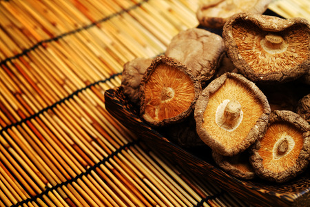 Dried Shiitake Mushroom on mat earth tone background Stock Photo