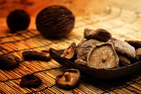 earth tone: Dried Shiitake Mushroom on mat earth tone background Stock Photo