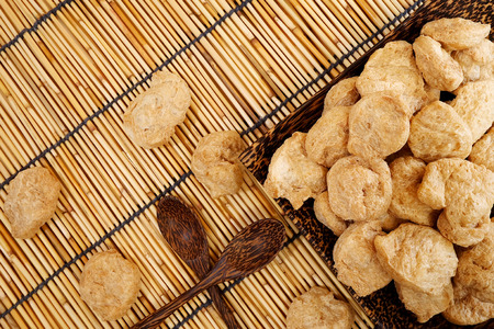 spurious: chunk Textured Vegetable Protein for Vegetarian Festival with earth tone flat lay background