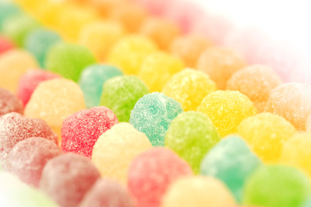 sugarplum: many colorful fruit gelatin in soft focus texture background