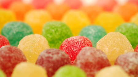 many colorful fruit gelatin in soft focus texture background