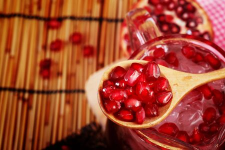 Pomegranate juice set on wooden mat background