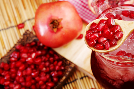 potation: Pomegranate juice set on wooden mat background