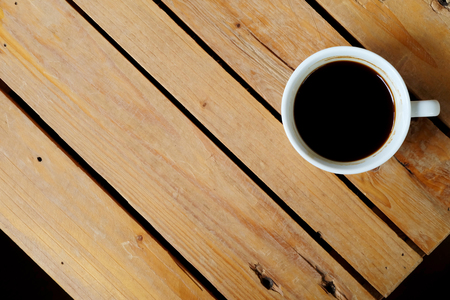 notion: flat-Lay view of hot black coffee on rough table and have some space for write wording
