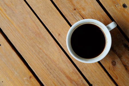 flat-Lay view of hot black coffee on rough table and have some space for write wording
