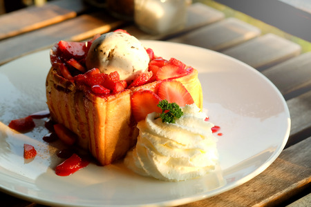 admire: Dessert honey toast with ice cream and strawberry for romantic sweet time in valentines day