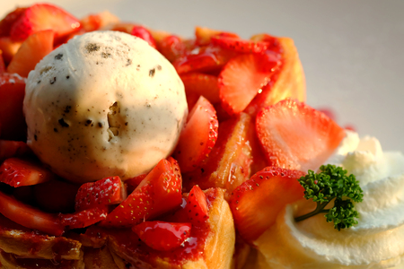 Dessert honey toast with ice cream and strawberry for romantic sweet time in valentines day