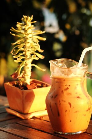 Fresh by ice espresso coffee in jar with evening light