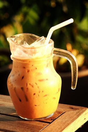 potation: Fresh by ice espresso coffee in jar with evening light