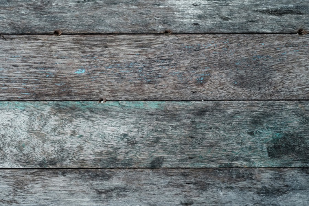 tableau: rough wooden wall with abrasive blue and yellow pain texture background. and have some space for write wording