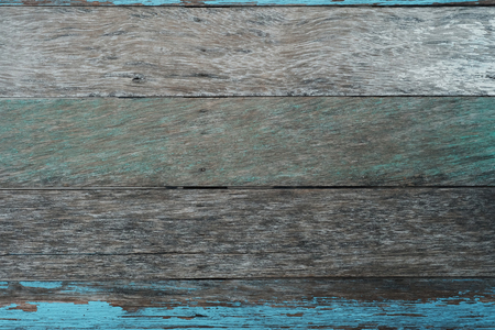rough wooden wall with abrasive blue background.