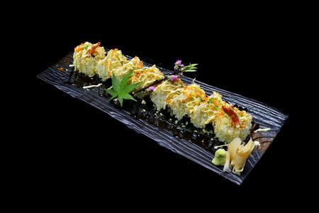 masticate: ebi tempura maki. Japanese sushi shrimp tempura roll on black isolated background. Japanese tradition fusion food style.