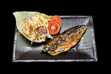 masticate: Saba steak with sweet sauce. grilled Saba fish with Japanese tradition fusion food style with black isolated background