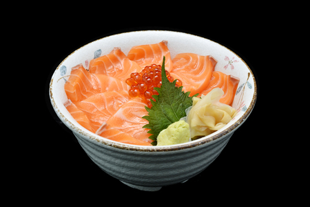 Salmon and ikura Chirashi sashimi of fresh raw Salmon and roe on rice of Japanese tradition food restaurant with white isolated background