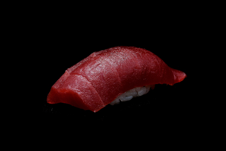 Akami sushi or Tuna sushi. Raw fresh Tuna fish top on Japanese rice. Japanese tradition food with black isolated background