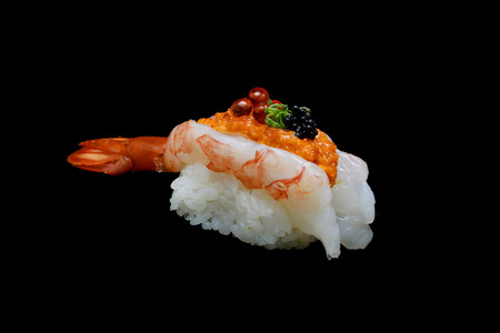 rawness: Botan ebi sushi or Spacial premium king shrimp sushi mixed by ikura and caviar top on Japanese rice. Japanese tradition food with black isolated background Stock Photo