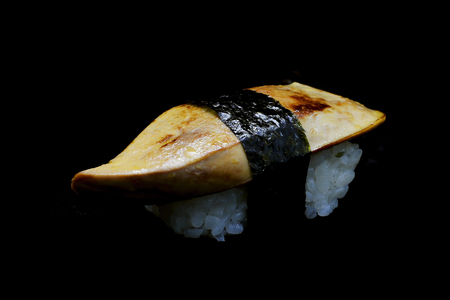 rawness: exclusive delicious Sushi with Foie garas sushi or goose liver top on Japanese rice rap by seaweed. Special premium Japanese tradition food. with black isolated background