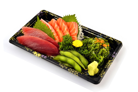Akami or tuna and Salmon Sashimi fill with Pigeon pea and spicy Seaweed salad Japanese tradition food in delivery low cost box set