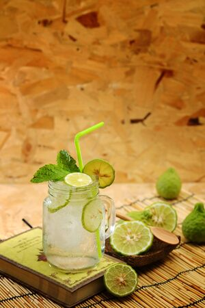 potation: Kaffir lime So, Bergamot soda Cool drink, Thailand tradition Herb for Treatment of Acid Reflux, with Oriental Earth tone map background.Have some space for write wording