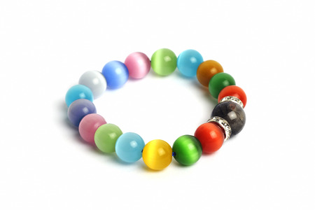supplement a good fortune ?? Black Rutilliated Quartz colorful Cats eye quartz stone bracelet amulet with white isolated background