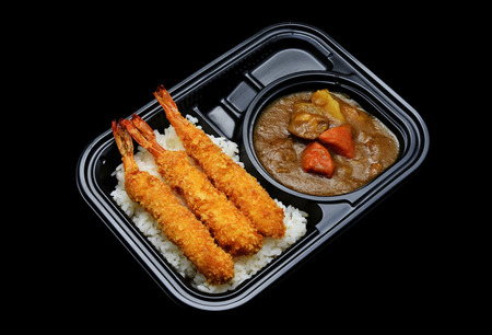 Express Japanese tempura curry rice box for delivery service. Japanese tradition cuisine with black isolated Foto de archivo