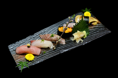 Japanese tradition food. Exclusive premium Sushi  set on wooden plate with black isolated background