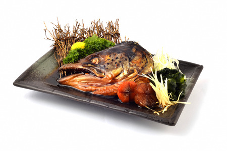 Salmon Head with special Soy Source. Japanese tradition cuisine with white isolated Stock Photo
