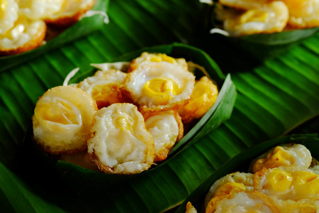 Kai krokQuail Egg mortar Served in Krathong made from banana leaves. Thailand tradition food in market steed