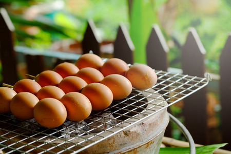 grill egg stick on grille is organic Thai tradition steed food in local market Stock Photo