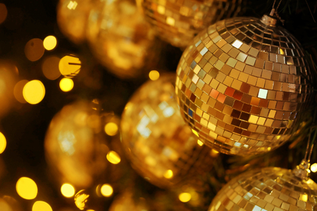 close up mirror ball or Christmas ball to decorative for Christmas festival with bokeh golden tone background. Have some space for write wording