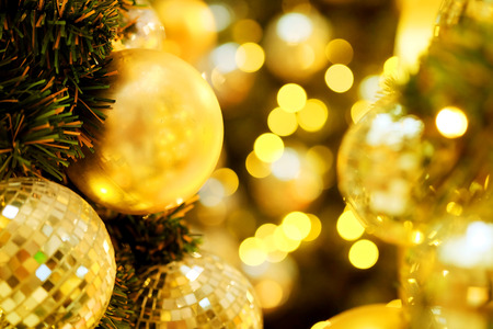 Close up golden Christmas ball to decorative for Christmas festival with bokeh background. Have some space for write wording