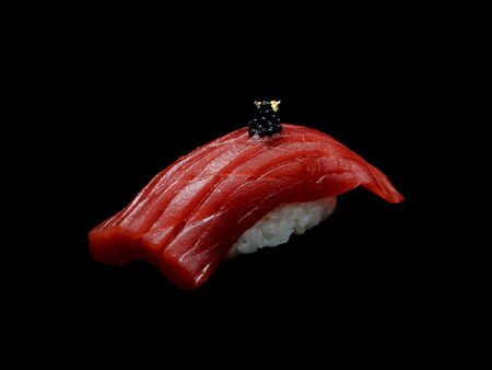 Chutoro is the name for medium fatty tuna when served in sushi restaurant. A Blue fin tuna yields Akami (red meat). Chu toro Shushi is slide tuna with Japanese rice. Japanese tradition meal 写真素材