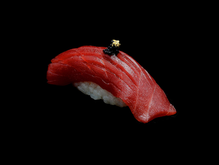 Chutoro is the name for medium fatty tuna when served in sushi restaurant. A Blue fin tuna yields Akami (red meat). Chu toro Shushi is slide tuna with Japanese rice. Japanese tradition meal Archivio Fotografico