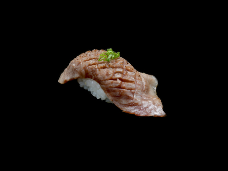 Matsusaka sushi is Japanese grill slide beef with Japanese rice with black isolated background .Matsusaka sushi is Japanese tradition meal.