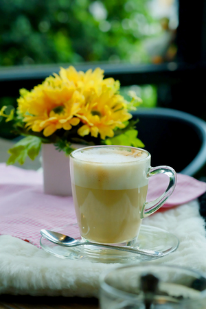 Hot Cappuccino Coffee on wooden table with cozy time.have some space for write wording