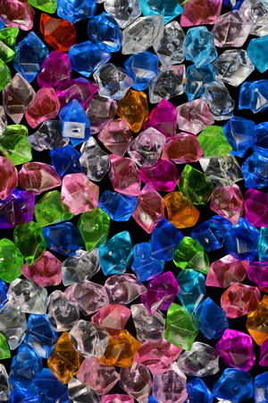 various colorful acrylic crystal stone crystal texture with dark night black background Imagens