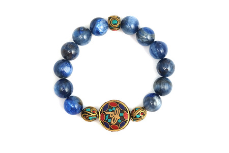 Kyanite or Cyanite lucky stone bracelet bead decorate with Chakra amulet accessories on white isolated background